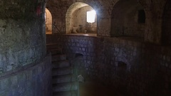 Gloomy cellar dungeon of old stone fort Stock Footage