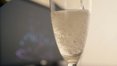 Pouring gold champagne into glass Stock Footage