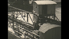 Vintage 16mm film, 1938 Coal mine surface conveyor belt medium shot Stock Footage