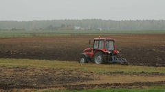 2016 October 2, Lithuania Panevezys district.Farmer plowing the field Stock Footage