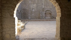 Tracking shot along archway corridor in old stone fort in town of Ston, Croatia Stock Footage