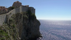 Dubrovnik old city walls on cliffs over sea Stock Footage