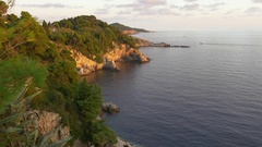Golden light of sunset on Croatian rocky cliffs coastline Stock Footage