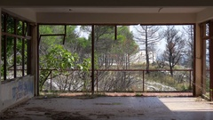 Inside destroyed abandoned building with panoramic window on Peljesac peninsula Stock Footage
