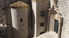 Panning up entrance of Dominican Monastery and Church in Dubrovnik Stock Footage