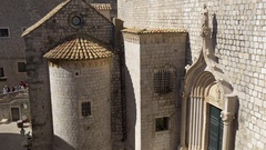 Entrance with statue of Dominican Monastery and Church in Dubrovnik Stock Footage
