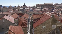 Narrow street and overview of Dubrovnik old town houses and churches Stock Footage