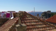 Clothes hanging and blowing on line over rooftops and fort Lovrijenac in Croatia Stock Footage