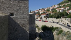 View from Dubrovnik old city walls to ouside street and houses on hill Stock Footage