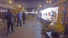 Tourists and locals visit the Christmas Market in Vladimirskaya street in Kiev Stock Footage