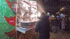 People buy hot and fragrant mulled wine at Christmas Market Stock Footage