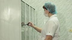 Woman doctor takes medicines from the Cabinet Stock Footage