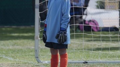 Young boy playing goalie in a youth soccer league game. Stock Footage