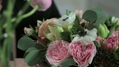 Florist hand make bouquets flowers in white box Stock Footage