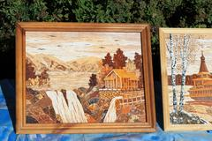 Pictures from birch bark handmade Siberian craftsmen depicting Russian land.. Stock Photos