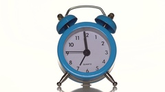 Alarm clock on white background Stock Footage