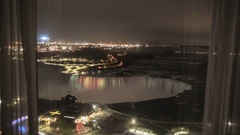 Time Lapse Overlooking Niagara Falls From Hotel Room Window at Night in 4K Stock Footage
