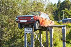 Homemade car Zaporozhets monument installed in the Siberian village Stock Photos