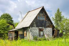 Suburban plot with house built during the times of the Soviet Union Stock Photos