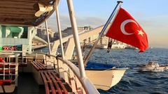 Cruising into old town with Turkish Flag waving on the stern of ship Stock Footage