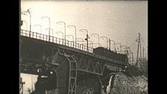 Vintage 16mm film, 1938 Coal mine surface, train crossing bridge Stock Footage