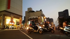 Traffic in the streets of Tainan at night Stock Footage