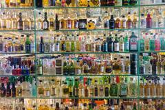 Mini bar bottles collection in the alcohol shop Stock Photos