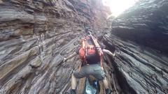 Hiker doing spider walk in Hancock Gorge in Karijini NP Stock Footage