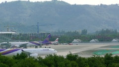 Boeing 767 of Thai Airlines turns on taxiway in airport Stock Footage