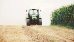 Agricultural tractor sowing and cultivating field Stock Footage