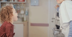 Female doctor checking a cute little girl in the infirmary Stock Footage