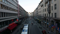 City street in Stockholm. Cars and bus driving by Stock Footage
