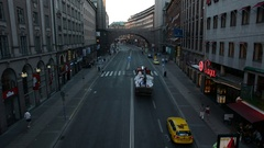 City street in Stockholm. Truck and cars driving by Stock Footage