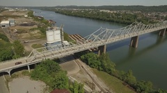 Aerial of the Aliquippa Ambridge Bridge and a concrete manufacturing plant Stock Footage