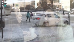 Reflection in a window of two girls in a cafe Stock Footage