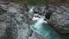 Aerial Shot Flying Through Rocky River Canyon With White Water Stock Footage
