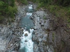 Aerial Shot Looking Down Flying Through Rocky River Canyon With White Water Stock Footage