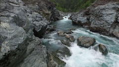 Aerial Shot Flying Low Through Rocky River Canyon With White Water Stock Footage