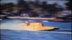 Crowd gathers to watch speed boat racing, 3893 vintage film home movie Stock Footage
