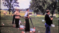 Trap shooting competition at local shooting range, 3895 vintage film home movie Stock Footage