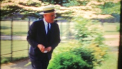 A man gets in his car & drives down the road, 3896 vintage film home movie Stock Footage