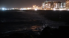 Storm surge powerful waves crashing into barrier, Reykjavik Iceland night Stock Footage