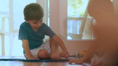 Kids playing with toys in indoor home Children playing with trucks  Arkistovideo