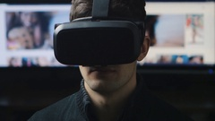 Man watching pornographic video using Virtual Reality headset Arkistovideo