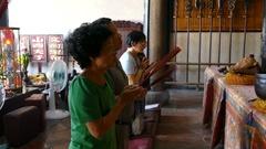 People praying in a temple in Tainan, Taiwan Stock Footage