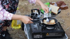 Cooking toast on a camping butane gas stove Stock Footage