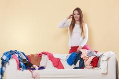 Desperate helpless woman in messy room home. Kuvituskuvat