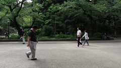 People walk and enjoy nice weather at Ueno park Stock Footage