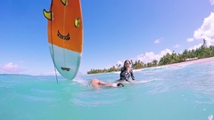 Two Surf Girls Sitting On Surfboards Loosing Balance And Falling Off Board Stock Footage