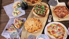 Eating individual pizzas from pizza bar. Stock Footage